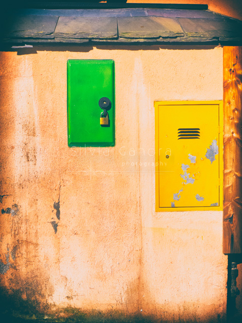 Yellow and green doors on a wall -